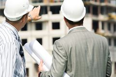 Backs of workers Stock Photo