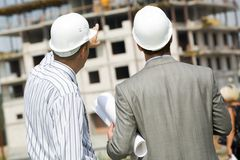 Backs of workers Royalty Free Stock Image