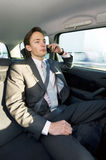 Backseat business call Royalty Free Stock Photography
