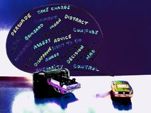 A Backseat Drivers Comments, Leading to a Toy Mock-up Car Crash. royalty free stock photo