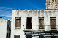 Backside of abandoned brownstone apartment building Stock Image