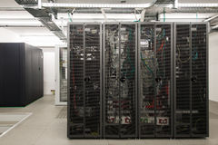 Backside of arranged black server racks Stock Image