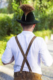 Backside of a bavarian man. Backside of a man in traditional bavarian clothes royalty free stock photo