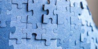 Backside of blue puzzle jigsaw Stock Photos