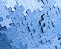 Backside of blue puzzle jigsaw Stock Photo