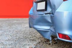 Backside of car get damaged by accident. Backside of blue car get damaged by accident stock photography