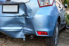 Backside of car get damaged by accident. Backside of blue car get damaged by accident royalty free stock photos