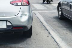 Backside of car has dented rear bumper damaged after accident. On the road Royalty Free Stock Photography