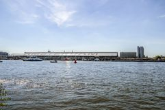 Backside Of The Central Station With A Ferry At Amsterdam The Netherlands 2018.  royalty free stock photography