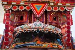 Front side of a truck. Backside decorated pakistani truck decoration art artist paint painter flower heart culture wheels auto bedford punjab jingle concept idea royalty free stock images
