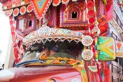 Front side of a truck. Backside decorated pakistani truck decoration art artist paint painter flower heart culture wheels auto bedford punjab jingle concept idea royalty free stock image