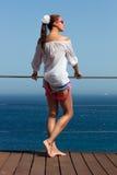 Backside of Fashionable Brunette Girl in Denim Shorts Royalty Free Stock Images