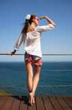 Backside of Fashionable Brunette Girl in Denim Shorts Stock Photos