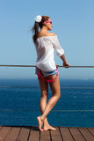 Backside of Fashionable Girl in Denim Shorts. Beauty Legs. Backside of beautiful woman body in denim jeans shorts enjoying the holidays Royalty Free Stock Photos