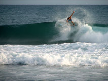 Backside floater. Surfer doing a backside floater at Soup Bowl, Barbados stock photo