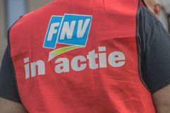 Backside Of A FNV Union Jacket With The Text FNV In Action At Amsterdam The Netherlands 2018. Demonstration Of Trigion Employees For A Better Collective royalty free stock photos