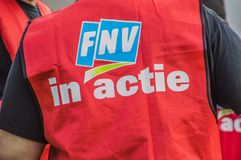 Backside Of A FNV Union Jacket With The Text FNV In Action At Amsterdam The Netherlands 2018. Demonstration Of Trigion Employees For A Better Collective royalty free stock image
