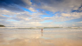 Backside Little Boy Runs to Shallow Sea Water Towards Waves stock video