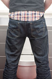 Backside of man urinating standing up Stock Images