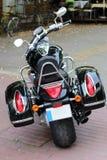 Backside of motorcycle. Backside of powerful black motorcycle royalty free stock photo