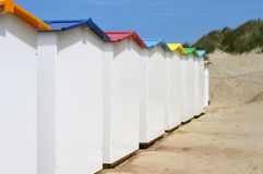Backside of new beach huts. Newly built and painted beach huts for summer holiday season by seaside Royalty Free Stock Photo
