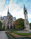 Backside of Notre Dame Cathedral and Statue Stock Image