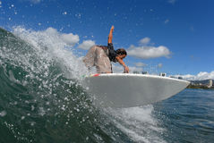 Backside off the lip. A shortboarder surfing hitting the lip royalty free stock image