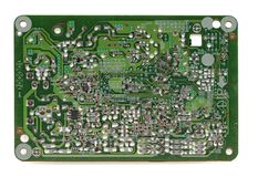 Backside of old electronic circuit board isolated on white. Background Stock Photos