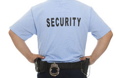 Backside of security guard. A backside view of a security guard with handcuff behind him, isolated against a white background royalty free stock photos