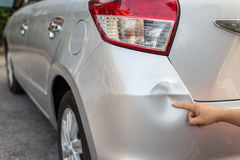 Backside of silver car get damaged by accident. Backside of new silver car get damaged by accident stock photos