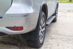 Backside of silver SUV car get scratched, damaged by accident. Backside of new silver SUV car get scratched, damaged by accident royalty free stock photography
