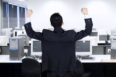 Backside of successful businessman in office Stock Photo