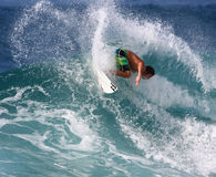 Backside surfer. Nov. 14: A Billabong team rider performs a backside maneuver at Backdoor on the North Shore of Hawaii Royalty Free Stock Image
