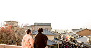 Backside of teen boy and girl 20-30 years old with japanese clot Royalty Free Stock Photography