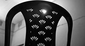 Backside of a traditional plastic chair. Isolated backside of a traditional plastic chair unique photo royalty free stock images