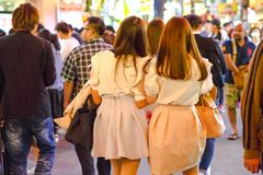 Osaka japanese woman. Backside of undefined Japanese women walking for shopping in the in Dotonbori area of Osaka city, in Japan. Night urban scene Stock Photo