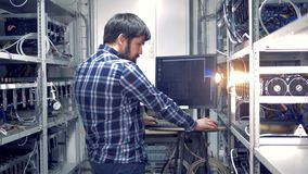 Backside view of an adult man working in a mining rig stock footage