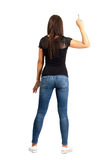 Backside view of asual woman with middle finger Stock Image