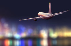 Backside view of commercial airplane, blur modern city on background Stock Photo