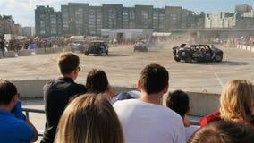 Backside View People Watch Dangerous Contest between Cars
