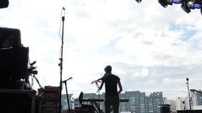 Backside View Woman Musician Plays Violin on Stage at Concert stock video footage
