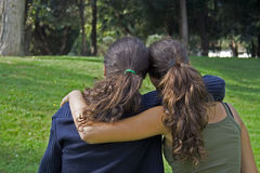 Backsister003. Two teen sharing a suport hug and looking for something stock image