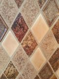 Tile glass backsplash in shades of brown. Kitchen tile glass backsplash in shades of brown an tan stock photo