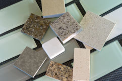 Backsplash tiles and quartz countertop samples. Glass subway tile samples used in kitchen backsplashes and quartz samples for countertops royalty free stock image