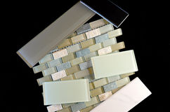 Backsplash and wall tiles against black. Glass subway tile mesh mounted mosaic tile ceramic and porcelain tile samples used in kitchen and bathroom backsplashes stock image
