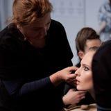 backstabbing Makeup för catwalk royaltyfri foto