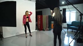 Backstage fashion model photographer lifestyle stock footage