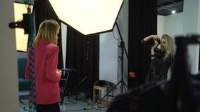 Backstage fashion model photographer communication stock video