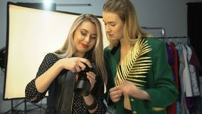 Backstage photographer workspace hobby lifestyle. Backstage fashion photography. professional workspace. ideas discussion. hobby art creativity lifestyle stock video footage