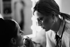 Backstage - make up session with two girls                           stock photo